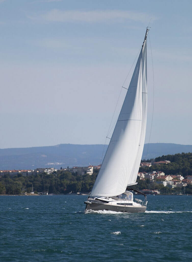 yacht with white sails