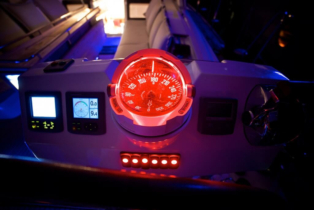 luxury compass on the yacht control panel