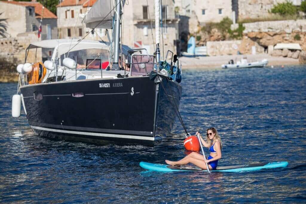 paddleboarding near a yacht