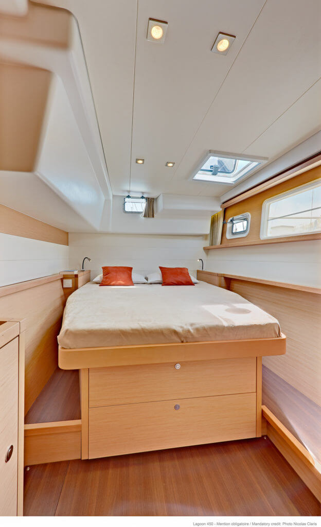 bedroom of a yacht with red pillows