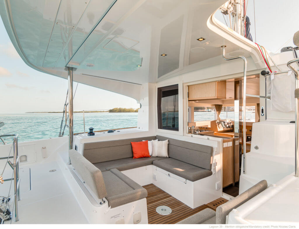 sitting in the back part of a yacht