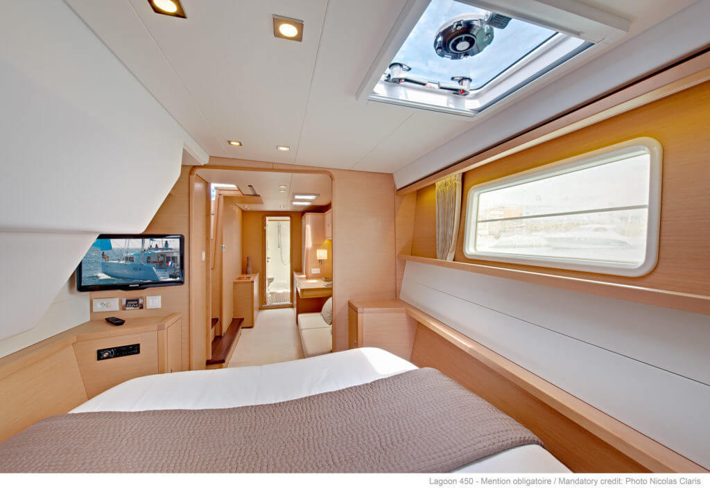 bed with a tv in a yacht
