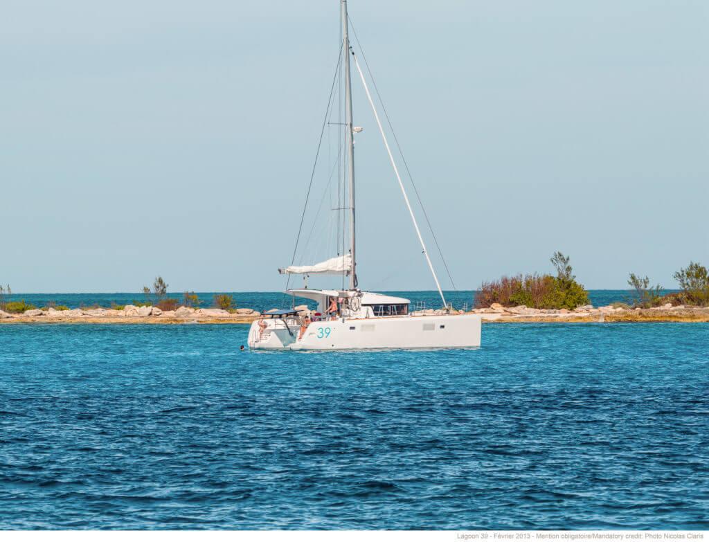 yacht parked near an island