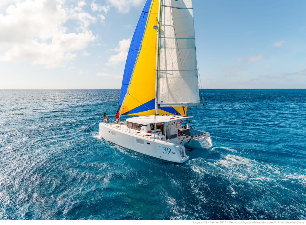 yacht with yellow and blue sails