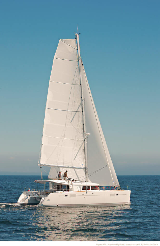 all white yacht sailing on a sea